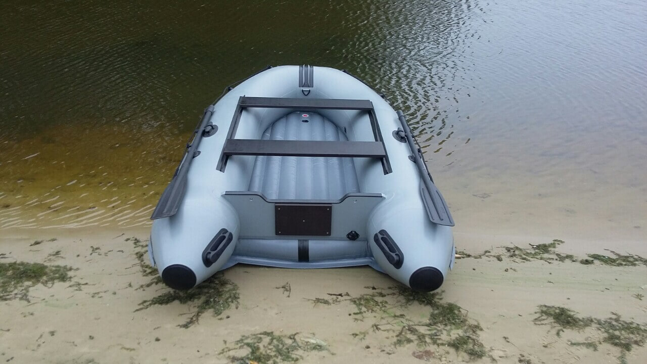 Inflatable PVC boats Boat with an inflatable bottom by the shore